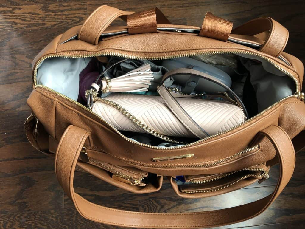 Have twins? Find out the Infant twin diaper bag essentials to pack when going out, types of twin backpack diaper bags, diaper bag checklist and essentials to keep in your trunk